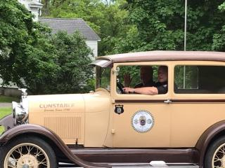 Photo of Old Police Car in Parade